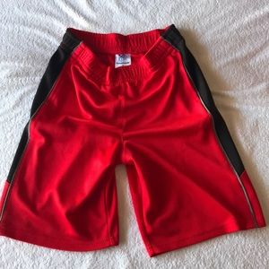 Gym shorts pockets black sides red fabric